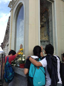 Worshipers at the Our Lady of the Candles shrine.
