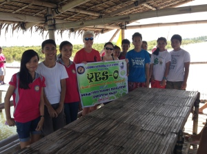 With volunteers at mangrove bagging