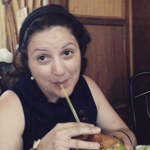 Enjoying a refreshing drink of boku (coconut juice)